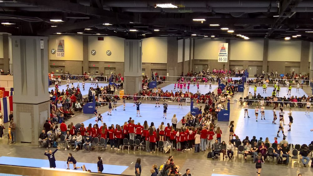 Academy Girls Stand Together  - The girls of Academy surround the court as the Girls 12 Red competes in a match.  The girls thrived in the support as Academy values were on in full display.