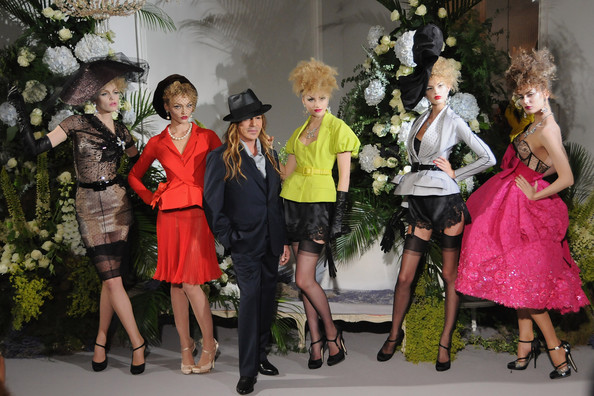 John Galliano, former creative director and designer at Dior, with models
