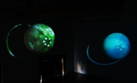Left: Earthplanet (2014)   Right: Waterplanet (2014)   Video projections onto floating spheres   Photo: Andrew Frost