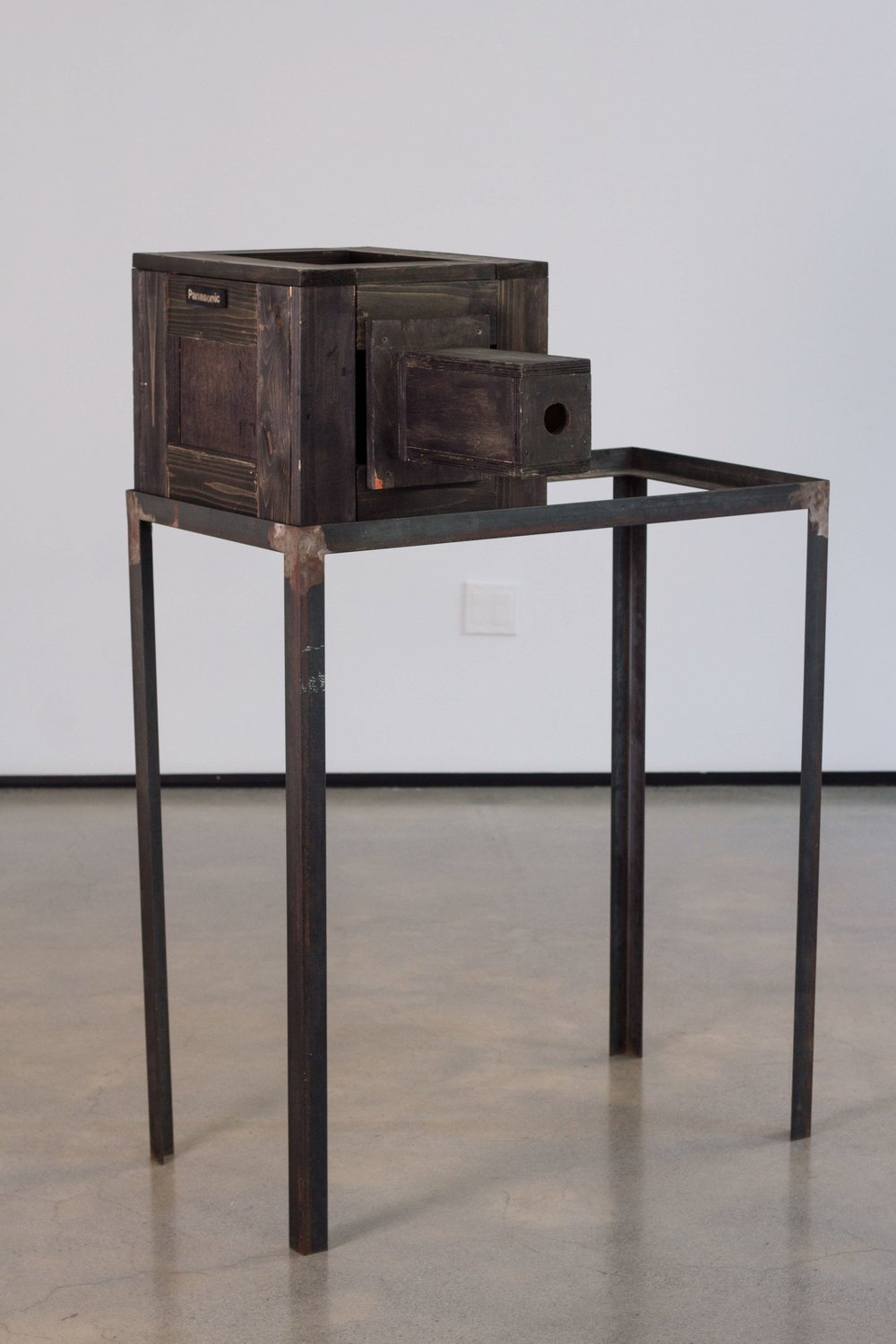 Tommy Hartung    Camera , 2009  Metal table frame and wood box  36 x 22 x 55in.