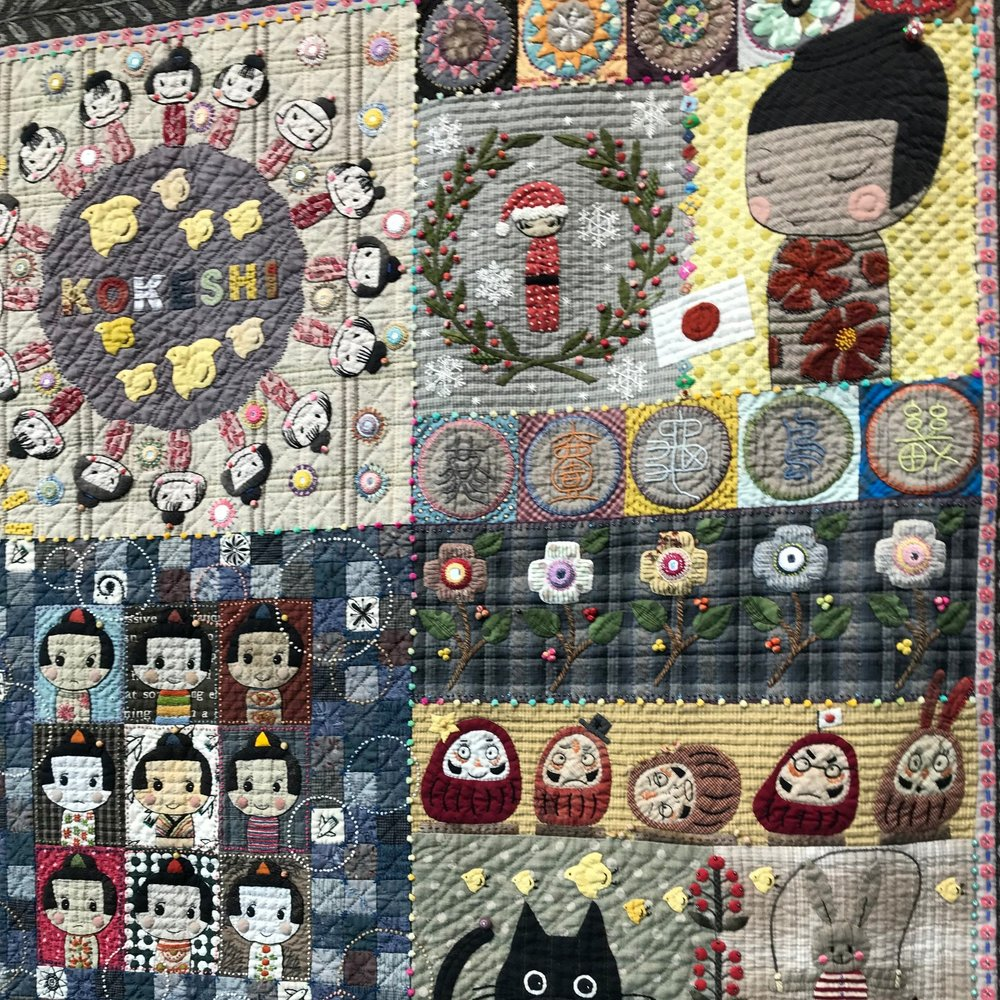 This stunning quilt shows the traditional Kokeshi Dolls that are so typical in Japan. See more pictures of this amazing quilt below.