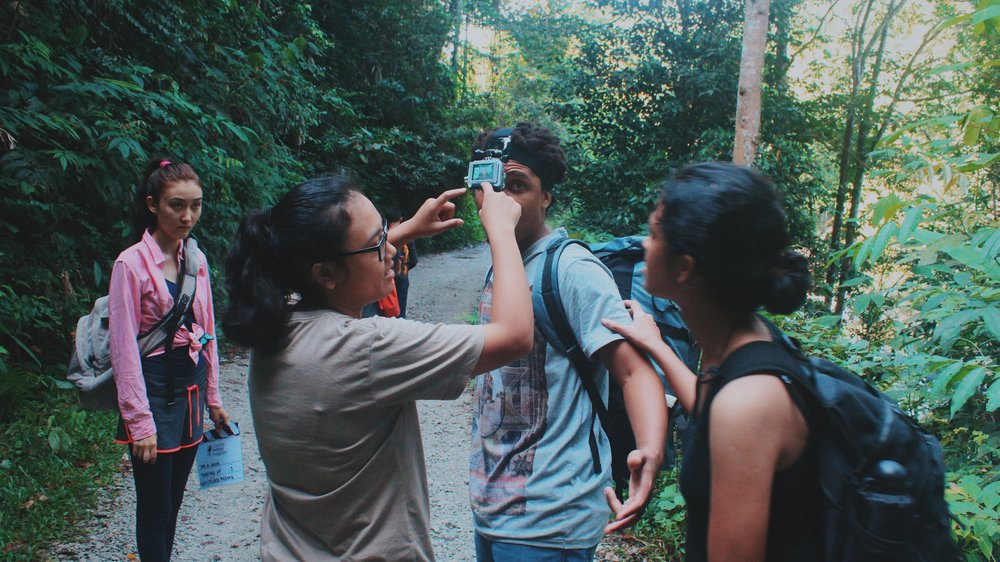 Director Nik & I discussing the GoPro setup before we trekked to the Lata Medang waterfalls