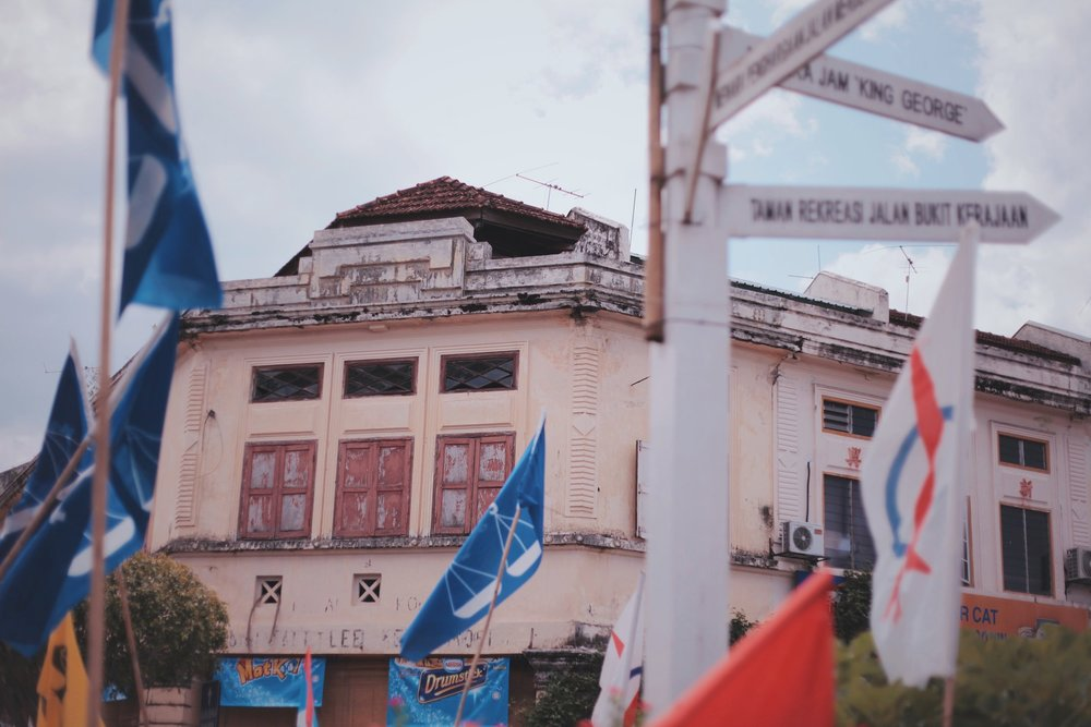 An old building surrounded by political party flags