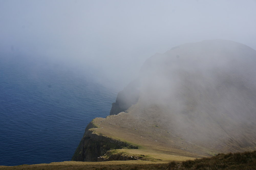 Clouds flooded in across Village bay engulfing me in drizzle as I climbed to the summit.