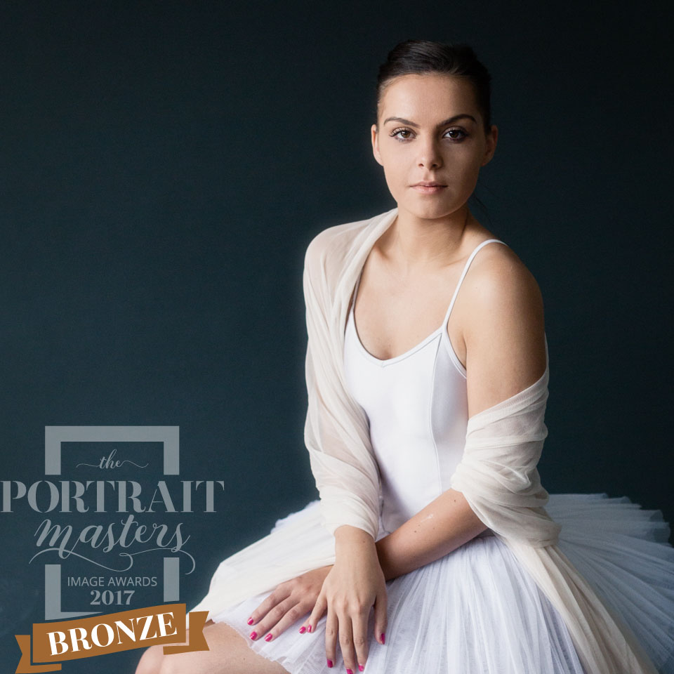 Portrait of a young girl dressed as a dancer with a white tutu and tulle. The Dancer. A dance style portrait, you don't have to be a dancer, embracing a childhood dream is enough.