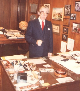 John started off in sales and eventually located permanently in Davenport, where he stayed working until his retirement in 1994. Here is a photo of John at his Davenport, Iowa office (circa 1980).