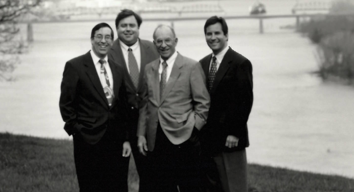 This is a picture of the Schmid family members working at Crescent headquarters in 1995. Three of the four next generation Schmid's working in the company are picture here.  Left to right, Jack Schmid, Dick Schmid, Jim Schmid and Mike Schmid