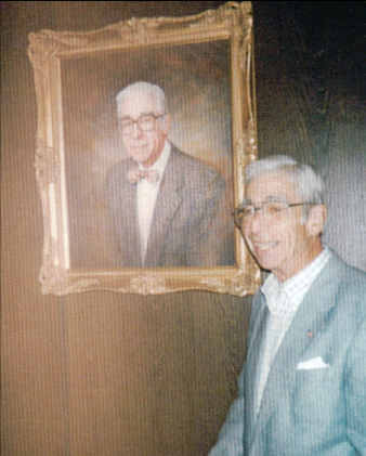 John Schmid in front of his portrait in the Boardroom at the corporate headquarters in East Dubuque, 1997.