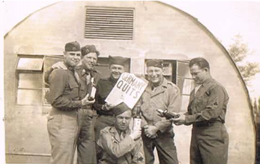 Tom and his military mates celebrate Germany quitting the war.