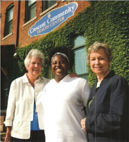 Mary Schmid, Crescent Community Health Center employee, and Janet (Schmid) Rhomberg in front of the Crescent Community Health Center in Dubuque, IA.