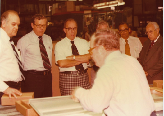 Don is second from the left at a product demonstration with Jim and Bill Schmid.
