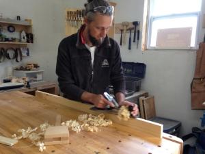 Jeremy Burrill in his casket shop