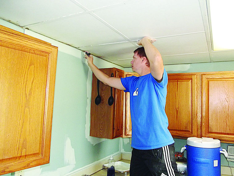 Photo Courtesy of Herald Palladium Scott Yack, IT Manager at Gast, paints in the kitchen of the Men's Shelter at the Benton Harbor Salvation Army.