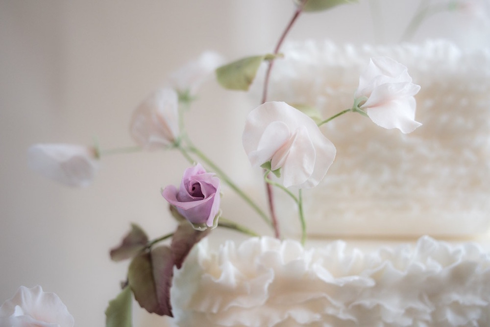 Rose and ruffle wedding cake