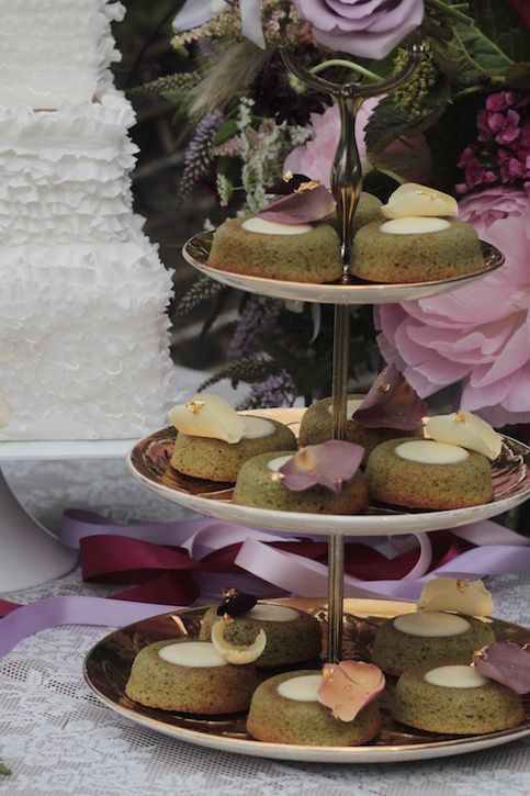 Wedding dessert table with pistachio and rose financiers