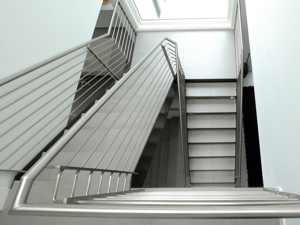 modern continuous rail industrial staircase return railing