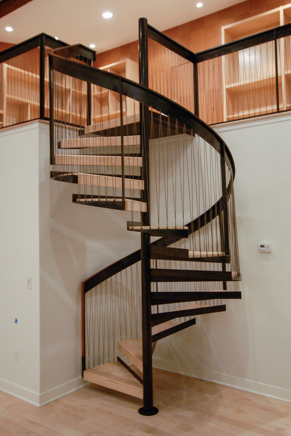Spiral Staircase w/Leather Handrail & Woven Cable