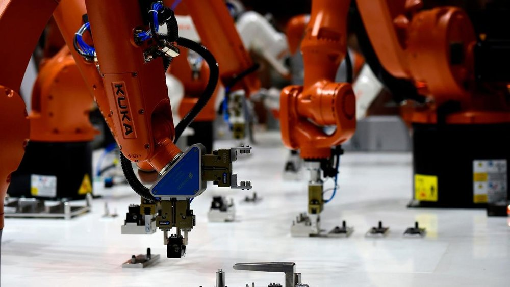 Once application-specific peripherals are added, robot systems like KUKA (robot arms pictured above) can cost anywhere from  $100,000 to   $150,000 . (Photo courtesy KUKA.)