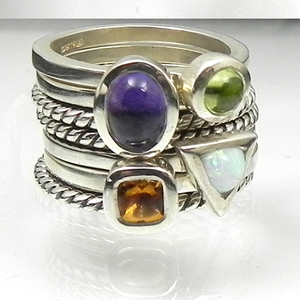 Beautifully designed and crafted jewelry by Karthia. Stackable rings for Mother's rings, Family rings, Friendship rings, Anniversaries, Birthdays, Graduations, etc. Karthia's rings are built to be together!