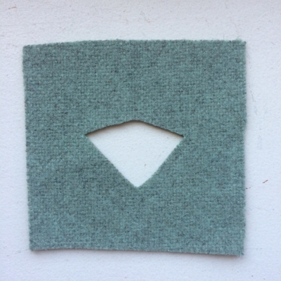 fabric square with piece removed to represent a loss