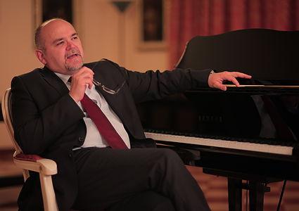 Nicolas Giusti by piano.jpg