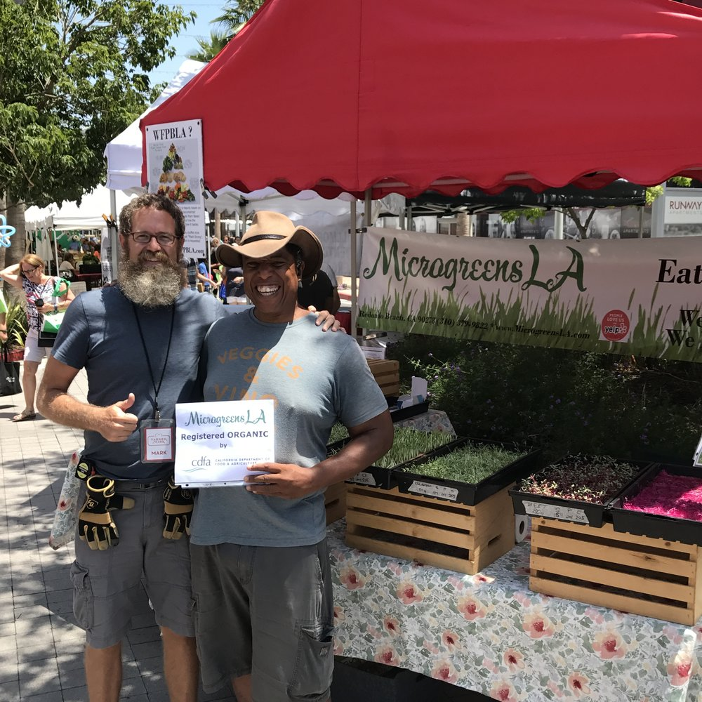 Farmer Mark and Farmer Joe celebrating MicrogreensLA Organic registration.