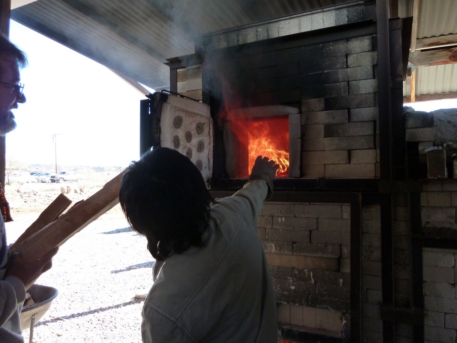 Tamie Stoking the Train Kiln