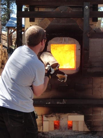 Stoking the NAU Switchback Kiln
