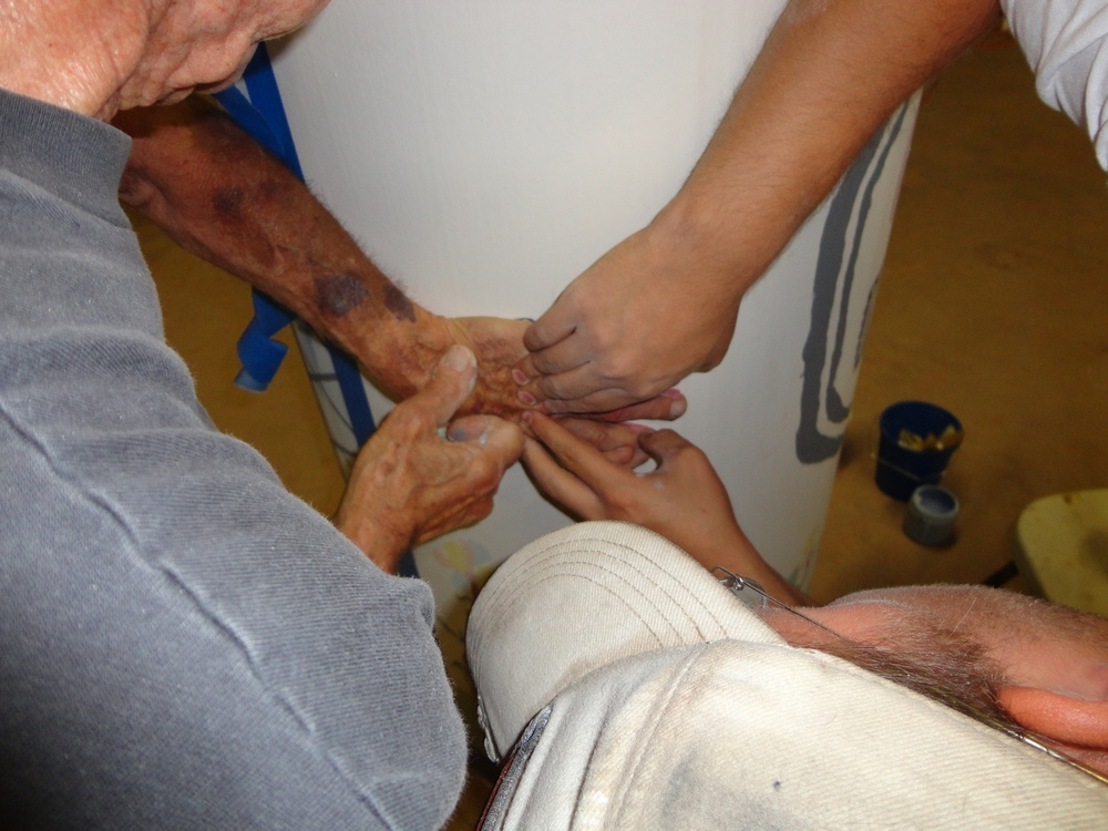 Pushing Don's hand on column