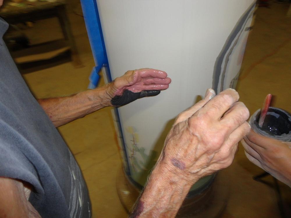 Applying underglaze to hand