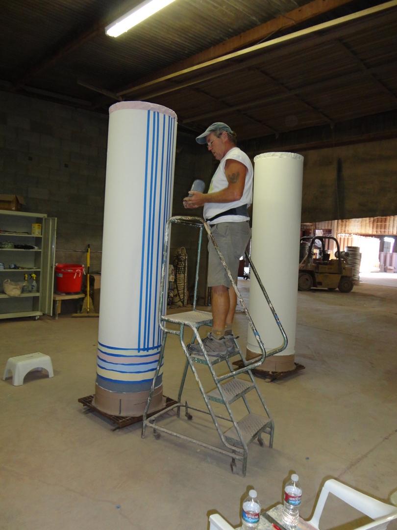 Larry Meagher applying underglazes