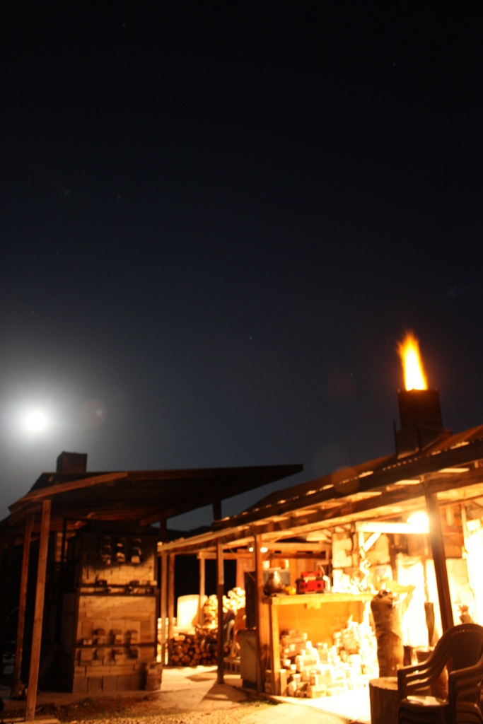 Moon over Train Kiln with flame out Woodkiln