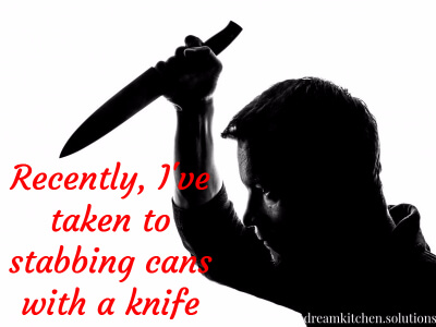 stabbing cans with a knife.jpg