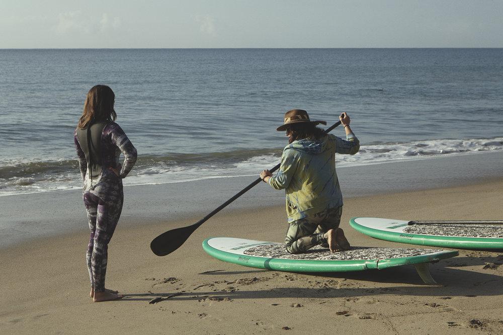 Jobi prepping Lisa for her Paddleboard Meditation