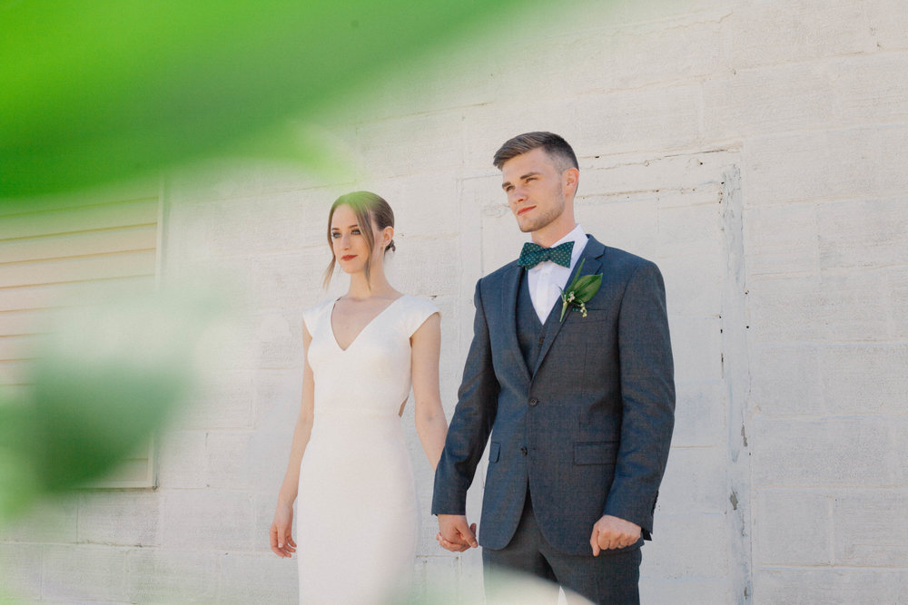 photo of bride and groom holding hands