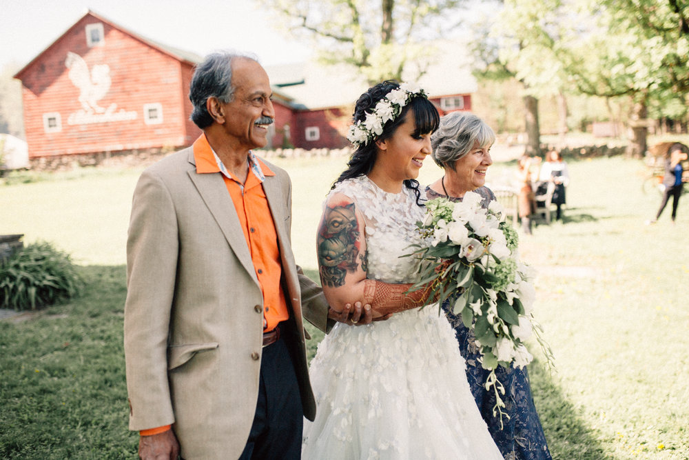 Parents walking their daughter down the isle