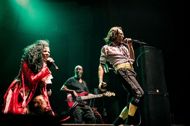 Pamela Racine, Thomas Gobena and Eugene Hutz on stage at the Newport. By: Kris Misevski.