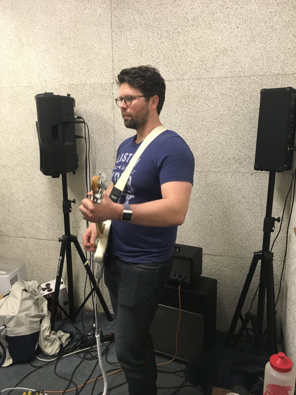 Gold From Grief guitarist Michael Furman gets into the zone while practicing with his band, a Tuesday tradition. (Photo by Zachary Kolesar)