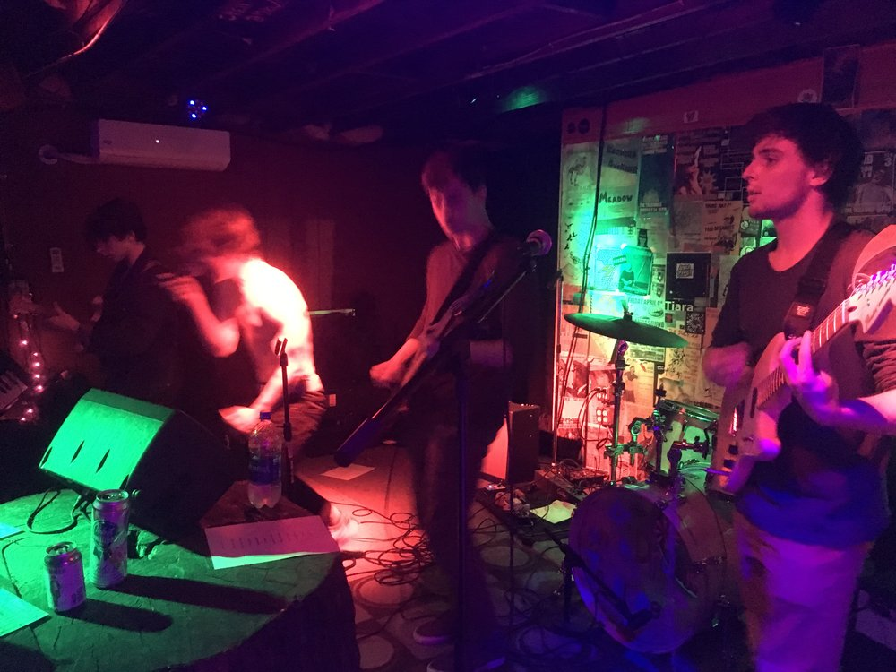Cousin Simple thrashes out at Tree Bar on Feb. 16 during a closing set. The Columbus rockers were joined by Oginalii, CHICO and Punch Drunk Tagalongs. (Photo by Zachary Kolesar)