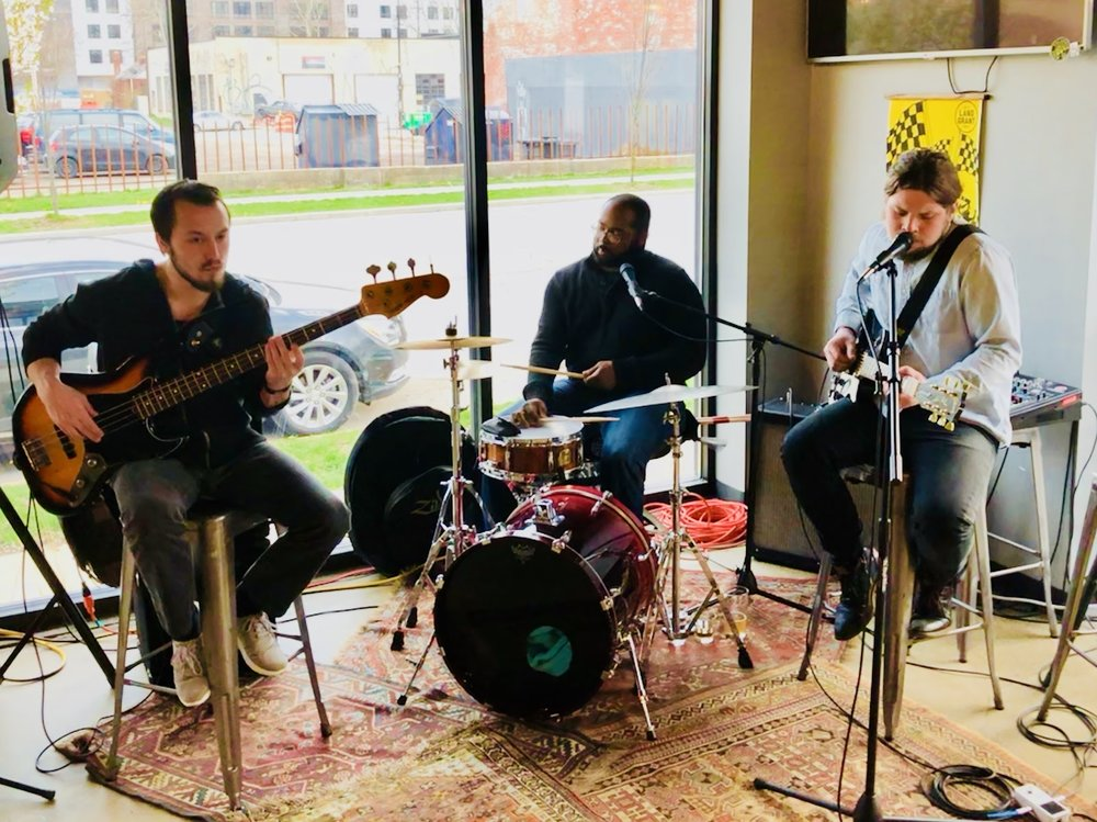 Parker Louis trio deep in the groove. Pictured left to right: Jeff Bass (Bass), Justin Campbell (Drums) and Parker Louis (Guitar). (Photo by Alex D.)