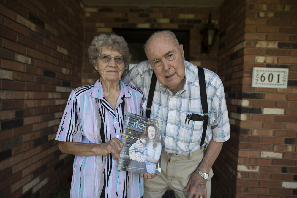 Carl and Ann hold magazine with Jill and Vaughan's story