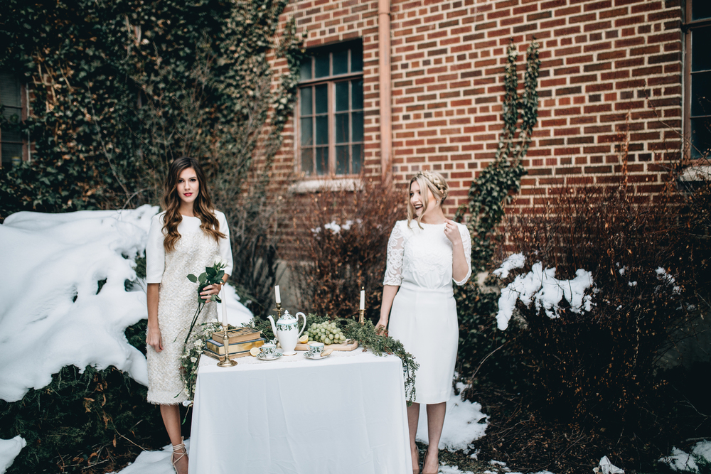 DETAILS  Styling by:  Lucy Bergstrom  Photography by:  Alice Cannon  Dresses by:  Aleksandra Salo  Makeup by:  Rachel Kae Jenkins  Rentals provided by:  Refined Vintage Events  Models:  Joan Brown  &  Josilyn Harsh