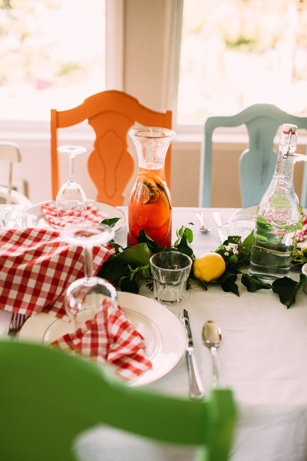 Placing drinks and water bottles down the table allow your guests to easily help themselves during the meal : plus they add a great splash of color and decor to your table scape!