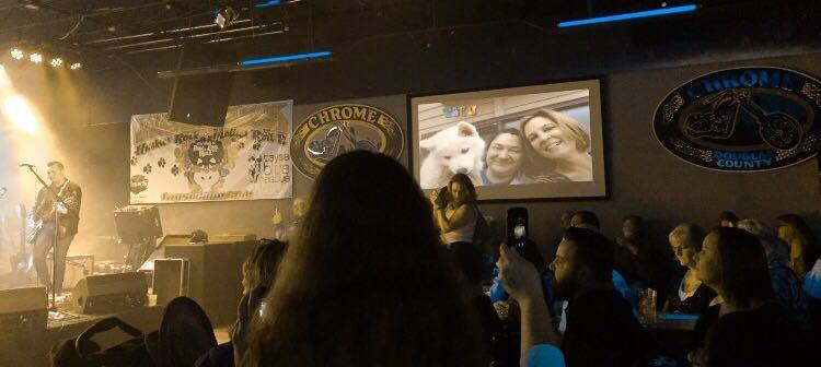 Huge crowds, lights, drinks, great music. But there's a slide show in the background that got most of my attention...my heart's with the dogs you guys. The slide show is of the 119 dogs rescued by Taysia Blue this year. I love this picture of Tofu, Becky and Tofu's Mom.