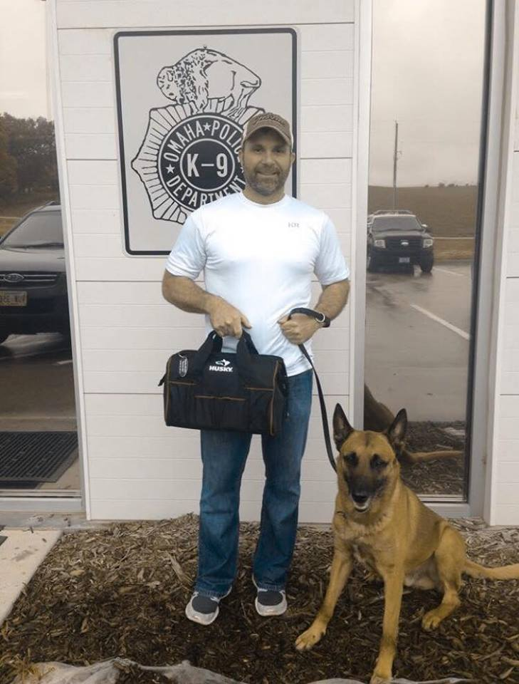 """Officer Matt McKinney and Kobus receiving their first aid kit in June 2015 in memory of Officer Kerrie Orozco. Used with permission of Officer Bridget Fitzpatrick of Omaha Police Department, caption details from """"We Ride to Provide"""" via Jenny Sutherland"""