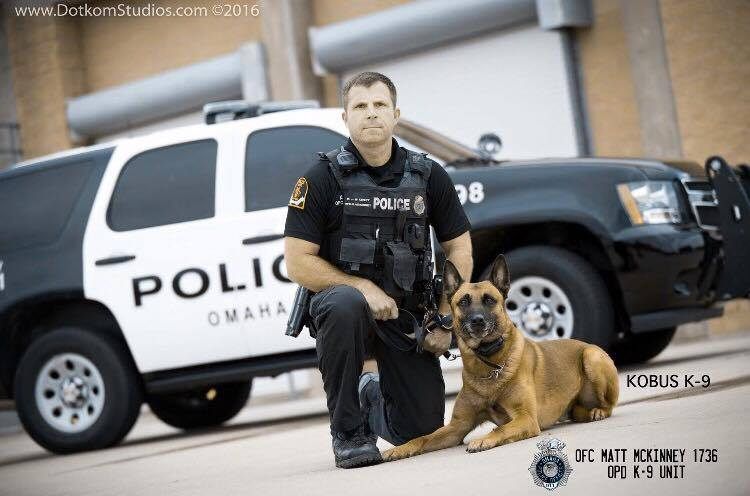 Officer Matt McKinney and Kobus. Photograph by Phil Hodges. Used with permission of Officer Bridget Fitzpatrick of Omaha Police Department