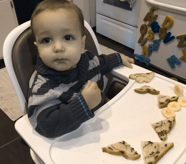 Robert with his raisin toast and sliced bananas - the breakfast of big brothers!