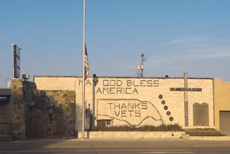 I love this mural. I can't believe I hadn't seen it before. It is in Kearney Nebraska. The flag was at half mast in honor of the police officers killed in Baton Rouge Louisiana.