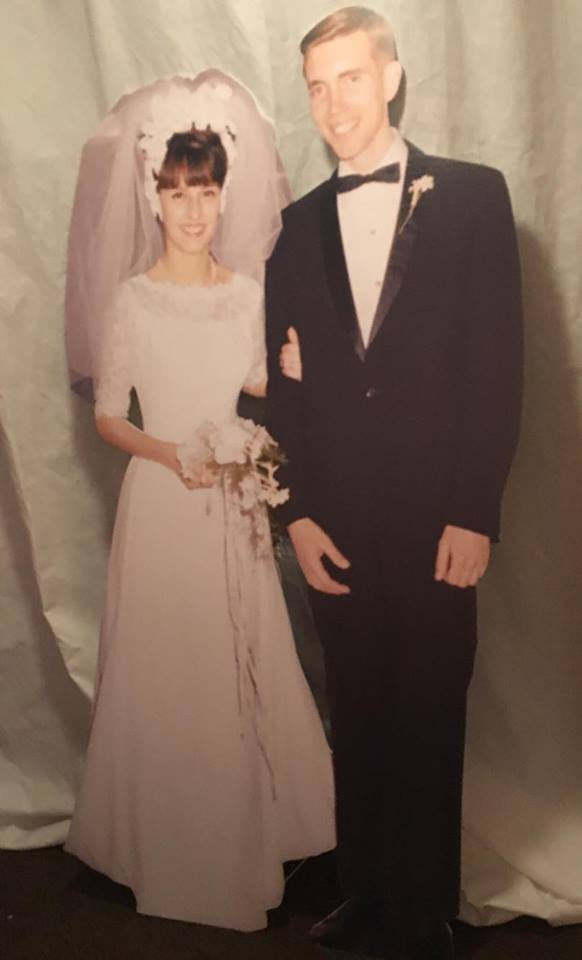 Dave had a life size cutout of Mom and Dad on their wedding day made :)