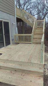 This is a large two level deck on a new home that ties the back of the house to the sliding door on the side in the basement.
